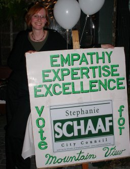 A picture of Stephanie Schaaf with her lawn sign and some Fred Art.